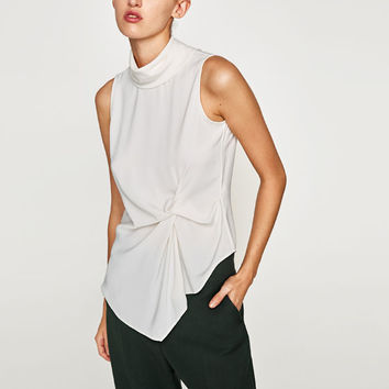 HIGH NECK DRAPED TOP DETAILS