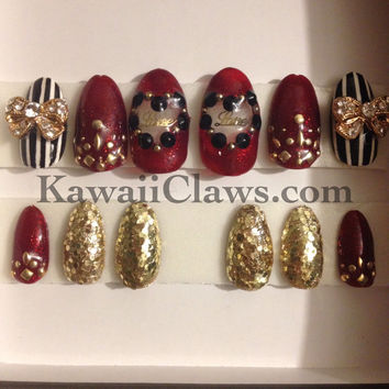 Red and Gold Glitter studded nails with heart cutout and black and white stripes 3D nail art false fake nails glam gyaru