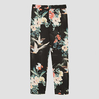 TROUSERS WITH BIRD PRINT AND FRONT DARTS DETAILS