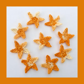9 small, crochet stars , appliques and embellishments