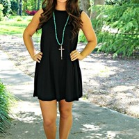 Sleeveless dress with scoop neckline and flowy fit.
