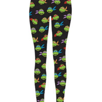 Featuring Teenage Mutant Ninja Turtles design, these black leggings have an all-over print of each Teenage Mutant Ninja Turtles- Raphael, Donatello, Michelangelo and Leonardo Print throughout, smooth stretch fabrication, taper cut and finish with elasticiz