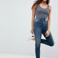 ASOS DESIGN Farleigh High Waist Slim Mom Jeans In Turya Aged Blue Wash at asos.com