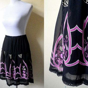 sheer black and pink printed A line skirt (free size)