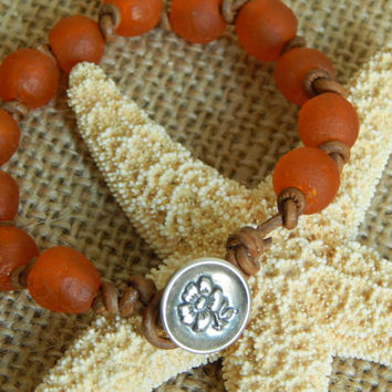 Bright orange glass beads, knotted leather bracelet, boho chic, fall color, sterling silver button, bohemian