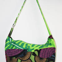 Green bike messenger bag with circle and leaf pattern