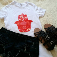 Red hamsa hand evil eye t-shirt available in white or black size s, med, large, and Xl for juniors girls and women