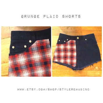 Grunge Plaid Jean Shorts. Navy dark blue denim. Vintage shorts. With faded plaid pattern in red, tan, and blue. Size Small.