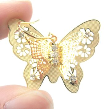 3D Butterfly Shaped Dangle Earrings in Gold With Floral Cut Out Details | DOTOLY
