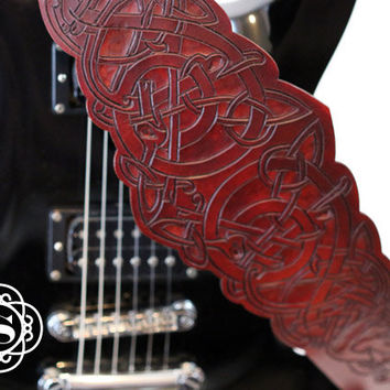 Viking animal and knot work red brown adjustable leather guitar strap.