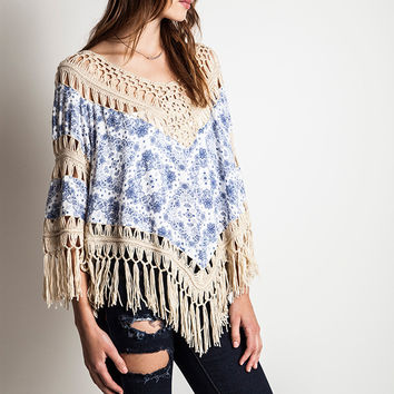 This cute gauze top features a beautiful knit crochet insert with paisley print cotton-blended panel construction, knit crochet v-neckline, three quarter sleeves insert with knit crochet and fringed detailing, and long fringe hemline. Unlined. Pair with sk