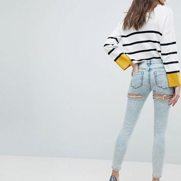 ASOS LISBON Skinny Midrise Jeans in Patience Light Wash with Bum Rips in Ankle Grazer Length at asos.com