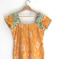 vintage yellow tunic dress with paisly print and green batik sleeves