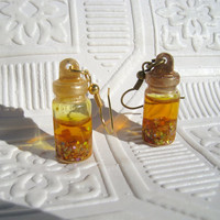 fire spell potion earrings tiny glass bottle earring video game