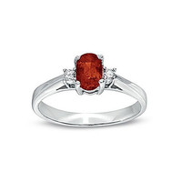 0.55cttw Ruby and Diamond Ring set in 14k Gold