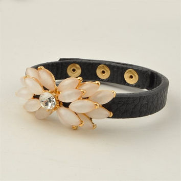 Leather cuff with gorgeous flower broach detail