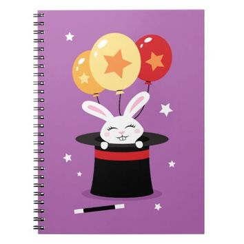 Rabbit in magicians hat and colorful balloons note book