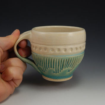 Ceramic tea cup, teal, hand thrown, carved wave design, nautical pottery