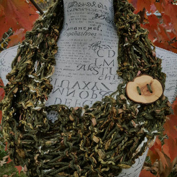 knit Infinity scarf. Avocado green Made by Bead Gs on ETSY.  skinny scarf. Drop stitch.