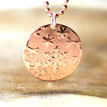 Hammered copper snowflake disc necklace