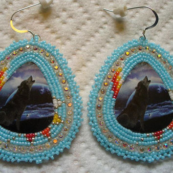 rosette beaded light blue wolf cabachon earrings