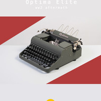 1952 Optima Elite Typewriter. Excellent condition. Refurbished & fully working. Portable. East Germany. Textured green. With case. WW2.