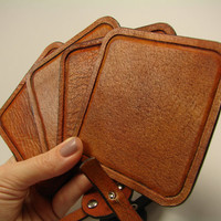 Set of square hand tooled leather coasters