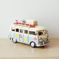 Hippie VW retro van, summer of love van miniature, retro collectible toy of a Volks Wagen hippie van in sky blue and cream with pink flowers