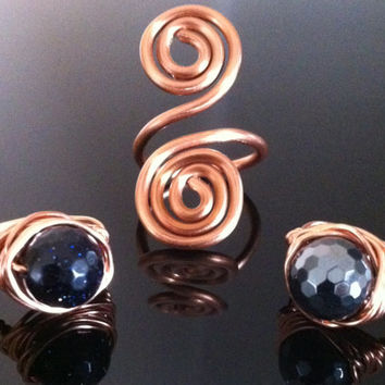 Faceted blue goldstone copper wire wrapped ring