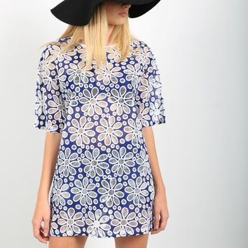 This beautiful oversize dress features white color daisy pattern embroidery against on semi-sheer navy color fabrication, round neckline, short sleeves construction, slip on style, slit on both side. Great for beach cover up or everyday dress wear with sli