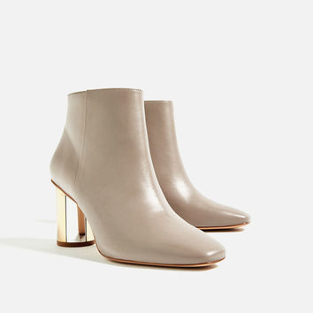 LEATHER ANKLE BOOTS WITH METAL HEEL DETAILS