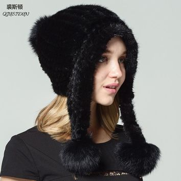 QIUSIDUN brand Natural fur mink hat Genuine factory outlets Fashionable with a fox ball Ear cap Winter Russian women Warm hats