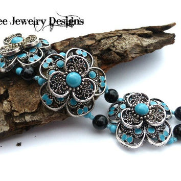 Silver and turquoise flower Bracelet knotted with cording, stone and silver.