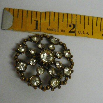 Vintage round gold tone rhinestone faux diamond wheel shaped pin, brooch 1950's, 1960's