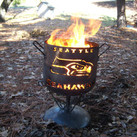 Seattle Seahawks compact fire pit of salvaged steel