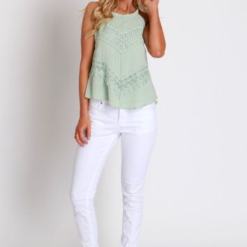 Mid Rise White Skinnies