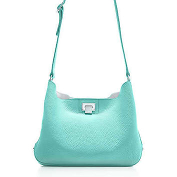 Tiffany & Co. - Dahlia crossbody hobo in Tiffany Blue grain leather. More colors available.