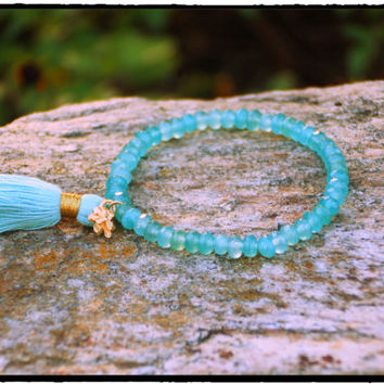 6mm Brazillian Aquamarine Stretch Bracelet with Tassel and Gold Plated Flower Charm Stretch Bracelet, Bohemian Chic, Chakra Surfer Chic