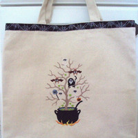 Halloween Trick or Treat Tote Bag Embroidered with a witches pot that has a tree full of creatures and Happy Halloween webs and spiders.