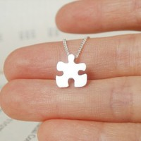 sterling silver jigsaw puzzle necklace, handmade in England