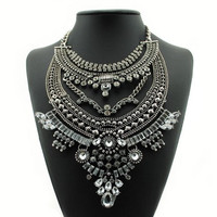 Rhinestone Floral Necklace with Hyperbolic Layered Beads