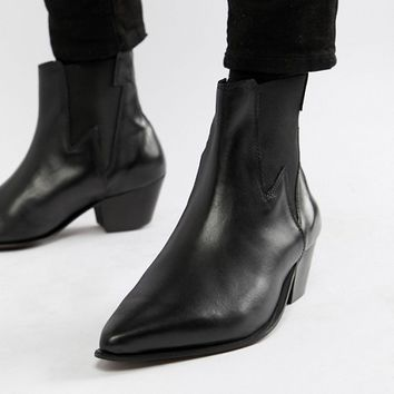 ASOS DESIGN stacked heel western boots in black leather with lightening detail at asos.com