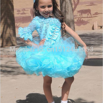 2016 Unique Turquoise Glitz Pageant Dress One Long Sleeve Ball Gown Design Cupcake Bottom Organza Kids Prom Flower Girl Dresses