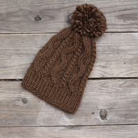 Knit beanie hat in chocolate brown color with cables and pom pom