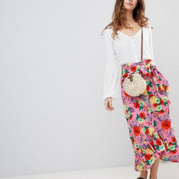 ASOS DESIGN cotton midi skirt with ruffle hem and belt in floral print at asos.com