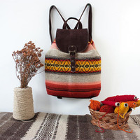 Handmade backpack with dark brown suede leather and unique colorful handwoven textile