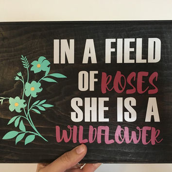 LATEST LISTING: In a Field of Roses She is a Wildflower wood sign