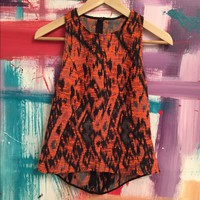 Gorgeous orange and black abstract sleeveless top