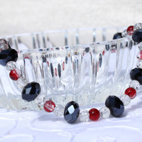 Swarovski crystal bracelet with black crystals and red/clear cracked glass beads