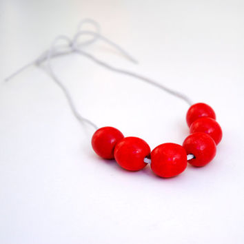 Red necklace with wooden beads on leather